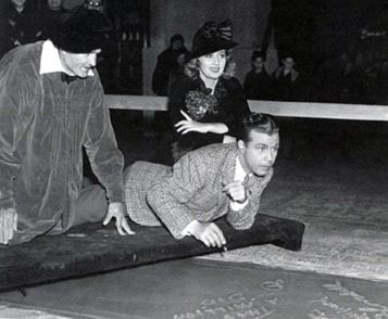 Dick Powell  and Joan Blondell placing their prints at Grauman's
