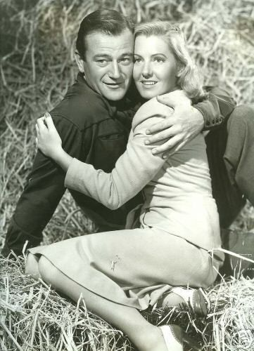 John Wayne  and Jean Arthur