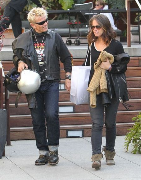 Rock legend Billy Idol and a female friend out shopping at Intermix in Malibu, Calfornia on March 24, 2012