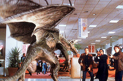 Ira (David Duchovny), Harry (Orlando Jones) and Wayne (Seann William Scott) confront a giant winged alien in a mall in Dreamworks' Evolution - 2001