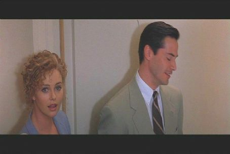 Mary Ann Lomax Charlize Theron and Keanu Reeves in Warner Bros's Devil's Advocate - 1997