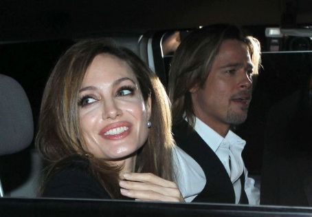 Angelina Jolie and Brad Pitt waving to fans as they head to the 'Make It Right Gala' in New Orleans, Louisiana on March 10, 2012