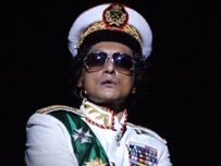 Ramon Tikaram  as Ghadaffi