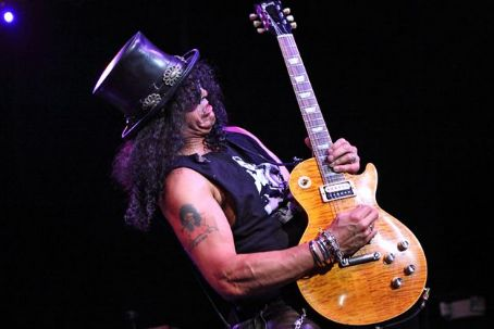 SLASH ADMITS HE ONCE FRENCH-KISSED A GIRAFFE