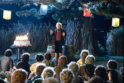 Ian Holm  as Bilbo Baggins, celebrating his birthday with friends in New Line's The Lord of The Rings: The Fellowship of The Ring - 2001