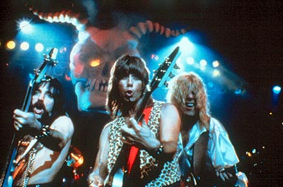 Bass player Derek Smalls (Harry Shearer), co-lead guitarist Nigel Tufnel (Christopher Guest) and lead singer/co-lead guitarist David St. Hubbins (Michael McKean) are Spinal Tap in This Is Spinal Tap - 1984, re-released by MGM in 2000