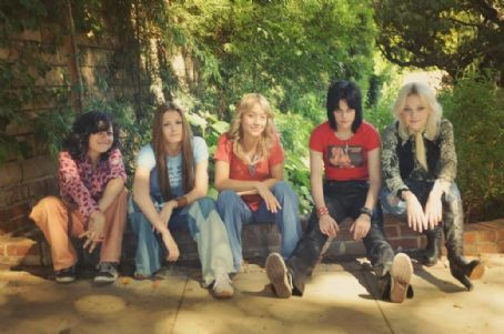 Stella Maeve Alia Shawkat as Robin, Scout Taylor-Compton as Lita Ford,  as Sandy West, Kristen Stewart as Joan Jett and Dakota Fanning as Cherie Currie in The Runaways.