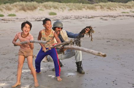 Boy Rocky (Te Aho Aho Eketone-Whitu),  (James Rolleston) and Alamein (Taika Waititi) playing war on the beach. Photos Matt Grace and Darryl Ward.