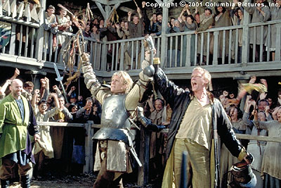 A Knight's Tale (From left to right) William (Heath Ledger) and Chaucer (Paul Bettany) celebrate one of the young knight's many victories on the tournament field in the Columbia Pictures presentation, A Knight's Tale - 2001