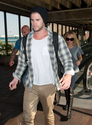 Miley Cyrus and Liam Hemsworth At Philadelphia International Airport (July 17)