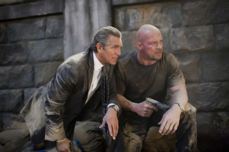 James Munroe (Eric Roberts, left) and Paine (Steve Austin, right) in THE EXPENDABLES. Photo credit: Karen Ballard