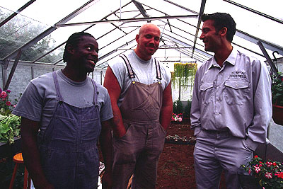 Paterson Joseph , Adam Fogerty and Clive Owen in IDP's Greenfingers - 2001