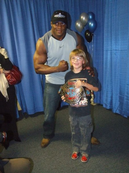 Bobby Lashley  with a fan at the Bowl With  WrestleMania 23 Make-A-Wish Foundation Charity Bowling Event on Saturday, March 31, 2007 at Skore Lanes, in Taylor, Michigan.