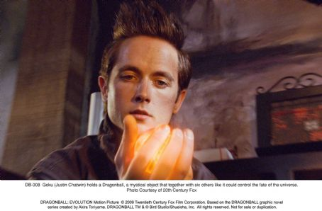 Goku  (Justin Chatwin) holds a Dragonball, a mystical object that together with six others like it could control the fate of the universe. Photo credit: Twentieth Century Fox.  ©2009 Twentieth Century Fox Film Corporation. All rights reserved.