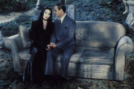 Morticia Addams Anjelica Huston and Raul Julia in The Addams Family (1991)