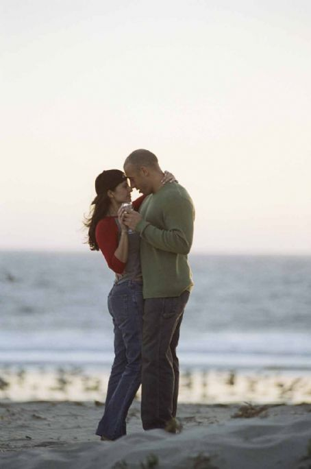 Jacqueline Obradors (left to right) Stacey Vetter () and her husband Sean (Vin Diesel) dance along the beach in New Line Cinema's action drama, A Man Apart.