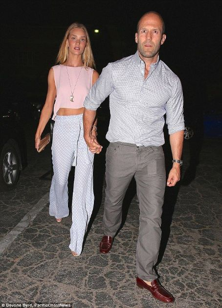 Rosie Huntington-Whiteley looks pretty as a petal in blush pink crop top on romantic dinner date with Jason Statham