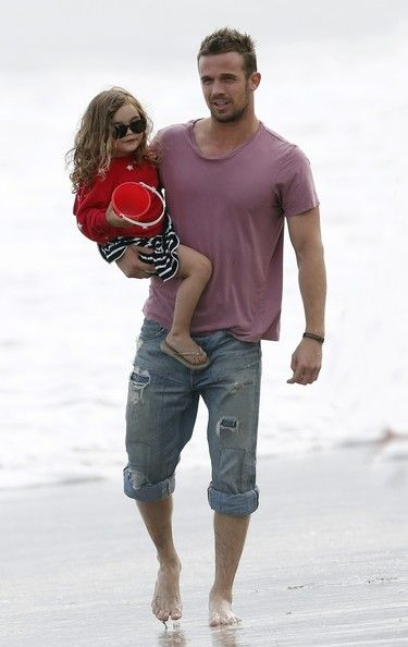 Cam Gigandet seen enjoy a walk with daughter Everleigh Rae during the 4th July celebrations on a beach in Malibu