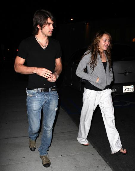 Miley Cyrus - Out In Hollywood With Justin Gaston, 2009-02-26