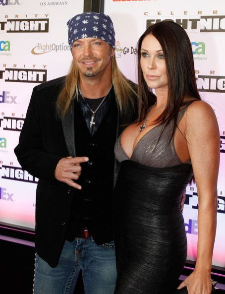 Musician Bret Michaels (L) and Kristi Gibson arrive at Muhammad Ali's Celebrity Fight Night XVII at JW Marriot Desert Ridge Resort & Spa on March 19, 2011 in Phoenix, Arizona.