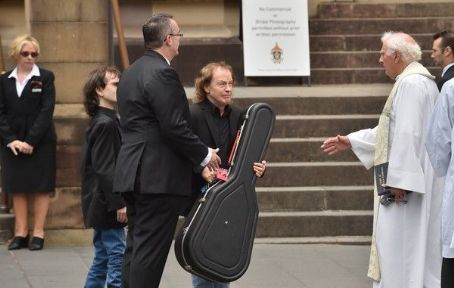 Angus Young at the funeral service for AC/DC co-founder Malcolm Young at St Mary's Cathedral on November 28, 2017 in Sydney, Australia