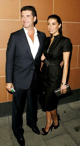Simon Cowell poses with his fiancee Mezhgan Hussainy after a meal out at C London Restaurant