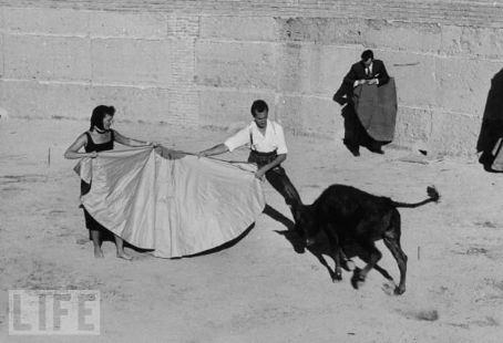 Luis Miguel Dominguín - Luis Miguel Dominguin and Mary Martin during Hilton Hotel opening spreading a cape to lure on charging heifer Jul 01, 1953