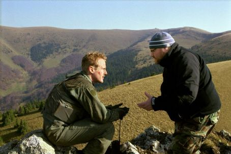 Behind Enemy Lines On location in Slovakia, Owen Wilson (left) confers with director John Moore in 20th Century Fox's  - 2001