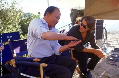 Mission: Impossible II - Director John Woo and Tom Cruise on the set of Paramount's Mission Impossible 2 - 2000