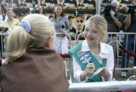 Cale Crane Dakota Fanning proudly became a member of the Girl Scouts at a special pinning held in Burbank on September 22, 2005.  Following the ceremony, Dakota treated her fellow Scouts to a special screening of her new movie, DreamWorks Pictures' Dreamer: Insp