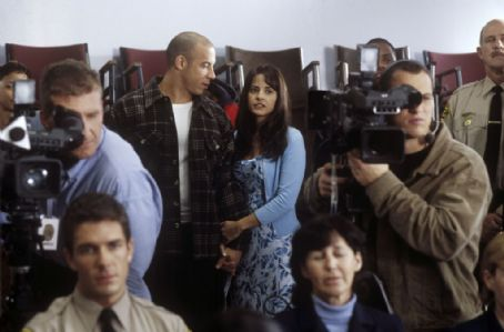 Jacqueline Obradors (middle background) (left to right) Sean Vetter (Vin Diesel) and his wife Stacey () in New Line Cinema's action drama, A Man Apart.