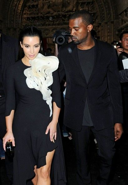 Kim Kardashian and Kanye West attend the Stephane Rolland Couture Spring/Summer 2012 showcase during Paris Fashion Week