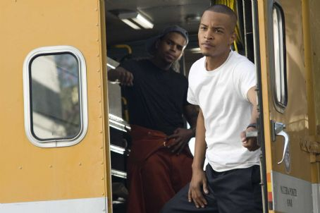 Chris Brown (left) and Tip 'T.I.' Harris star in Screen Gems' action thriller TAKERS. Photo By: Suzanne Tenner. © 2010 Screen Gems, Inc. All Rights Reserved.
