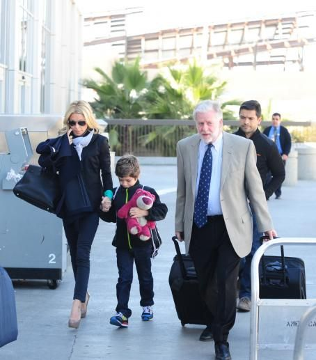 Kelly Ripa and Mark Consuelos depart from LAX airport with their youngest son Joaquin Consuelos - February 26, 2011