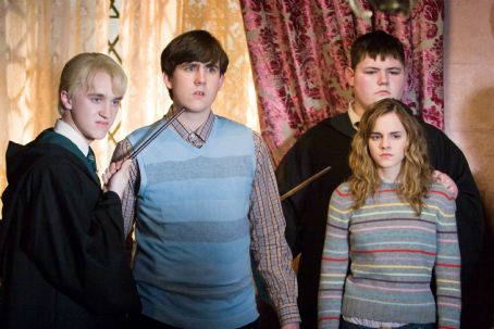 "Matthew Lewis (L-r) TOM FELTON as Draco Malfoy, MATTHEW LEWIS as Neville Longbottom, JAMIE WAYLETT as Vincent Crabbe and EMMA WATSON as Hermione Granger in Warner Bros. Pictures' fantasy 'Harry Potter and the Order of the Phoenix."" Photo by Murray Close."