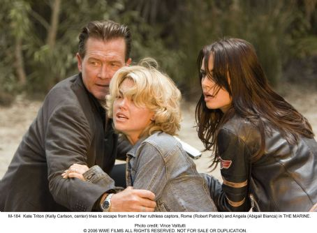 The Marine - Kate Triton (Kelly Carlson, center) tries to escape from two of her ruthless captors, Rome (Robert Patrick) and Angela (Abigail Bianca) in THE MARINE. Photo credit: Vince Valitutti