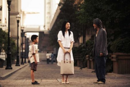 Stephen Chow Left to Right: Xu Jiao as Dicky Chow, Kitty Zhang as Miss Yuen and  as Ti Chow. © 2007 Star Overseas Group, Courtesy Sony Pictures Classics. All Rights Reserved.