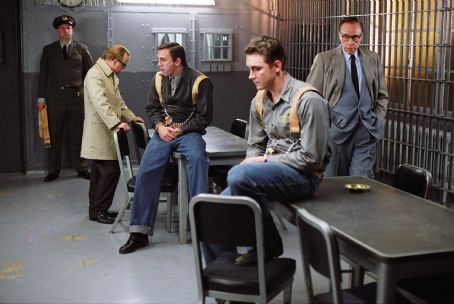 Toby Jones  as Truman Capote, Daniel Craig as Perry Smith, Lee Pace as Dick Hickcock, and Peter Bogdonavich as Bennet Cerf in director Douglas McGrath's Infamous, a Warner Independent Pictures release. Photo Credit: Deana Newcomb © 2005 Warner Bros.