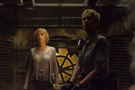 Laurie Holden  and Radha Mitchell searches Sharon together in scary building.
