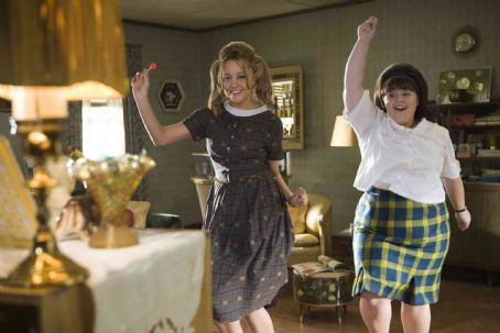 "Nikki Blonsky Amanda Bynes (left) stars as ""Penny Pingleton"" and  (right) stars as ""Tracy Turnblad"" in New Line Cinema's upcoming release of Adam Shankman's HAIRSPRAY. Photo Credit: ©2007 David James/New Line Cinema"