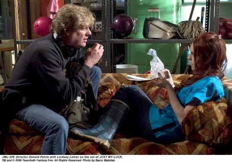 Ashley Albright Director Donald Petrie with Lindsay Lohan on the set of JUST MY LUCK. TM and © 2006 Twentieth Century Fox. All Right Reserved. Photo by Barry Wecher.