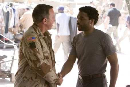 Left: Tim Allen as Chet Frank. Right: Chewitel Ejiofor as Mike Terry. Photo by Lorey Sebastian, © The Redbelt Company, LLC, courtesy Sony Pictures Classics. All Rights Reserved.