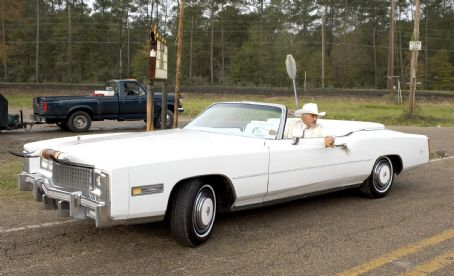Jefferson Davis 'Boss' Hogg BURT REYNOLDS as Boss Hogg in his white Cadillac in Warner Bros. Pictures' and Village Roadshow Pictures' action comedy 'The Dukes of Hazzard,' starring Johnny Knoxville, Seann William Scott and Jessica Simpson and distributed by Warner Br