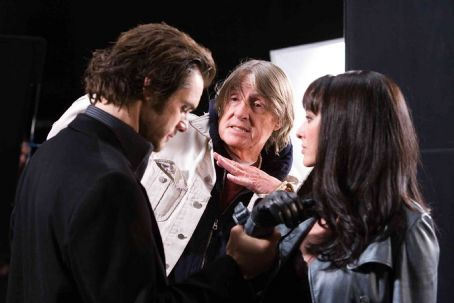 Joel Schumacher Jim Carrey (left), Director  (center) and Virginia Madsen (right) discuss the set-up of a shot on the set of THE NUMBER 23. Photo Credit: ©2007 Christine Loss/New Line Cinema