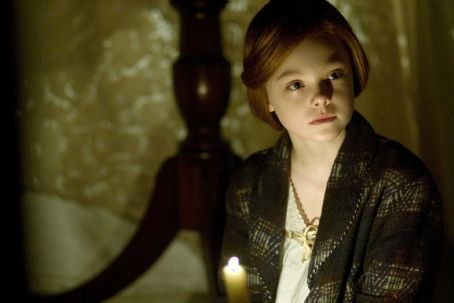"Elle Fanning  stars as the young Daisy in ""The Curious Case of Benjamin Button."" Photo Credit: Merrick Morton. Copyright © 2008 Paramount Pictures Corporation and Warner Bros. Entertainment. All Rights Reserved."