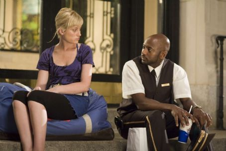 Romany Malco Working girl Angie (AMY POEHLER) confides in doorman Oscar (ROMANY MALCO).