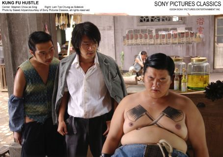 Stephen Chow Center:  as Sing; Right: Lam Tse Chung as Sidekick.