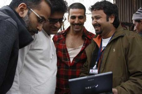 Akshay Kumar L-r: Producer ROHAN SIPPY, writer SHRIDHAR RAGHAVAN, AKSHAY KUMAR and director NIKHIL ADVANI on the set of the action comedy 'Chandni Chowk to China,' a Warner Bros. Pictures release. Photo by Sheena Sippy