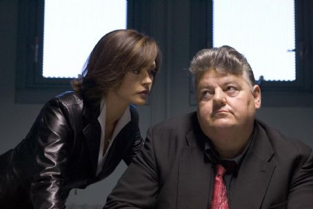 Robbie Coltrane - CATHERINE ZETA-JONES AND ROBBIE COLTRANE in 'Ocean's Twelve,' also starring George Clooney, Brad Pitt, Matt Damon, Andy Garcia, Don Cheadle, Bernie Mac and Julia Roberts and distributed by Warner Bros. Pictures.  Photo by Ralph Nelson SMPSP