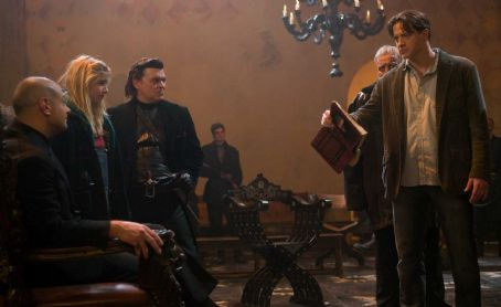 Meggie Folchart (L-R) ANDY SERKIS as Capricorn, ELIZA HOPE BENNETT as Meggie, JAMIE FOREMAN as Basta and BRENDAN FRASER as Mo in New Line Cinema's fantasy adventure 'Inkheart,' also starring PAUL BETTANY, HELEN MIRREN and JIM BROADBENT. This film is distribut
